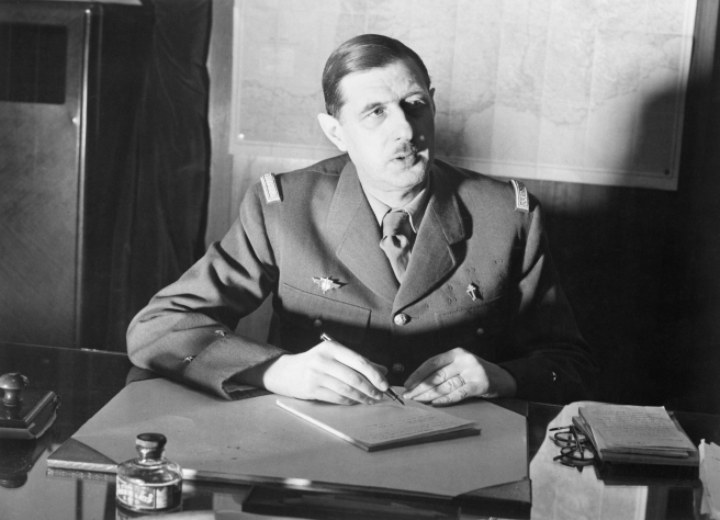 Commander_of_Free_French_Forces_General_Charles_de_Gaulle_seated_at_his_desk_in_London_during_the_Second_World_War._D1973